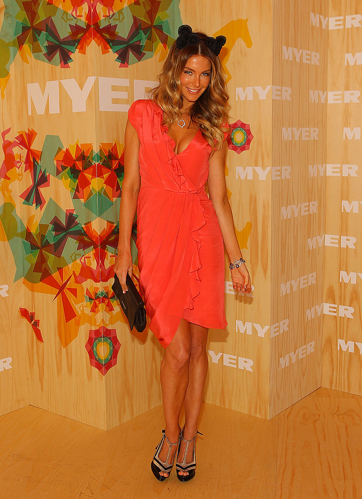 Jennifer Hawkins looks as cute as a kitten in that ear-esque head piece.