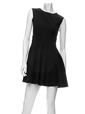 """""""This dress is so chic, very Audrey Hepburn. I'd go for minimal accessories, like a pearl necklace, to complete the look."""" Porter Grey Wool Twill Open Back Swing Dress ($410)"""