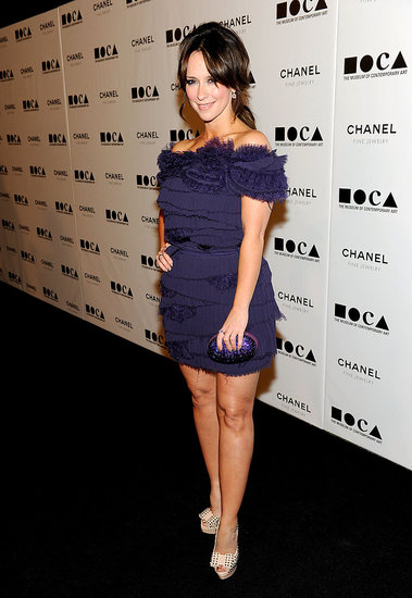 Jennifer Love Hewitt brought color and texture via a purple-hued Tadashi Shoji dress.