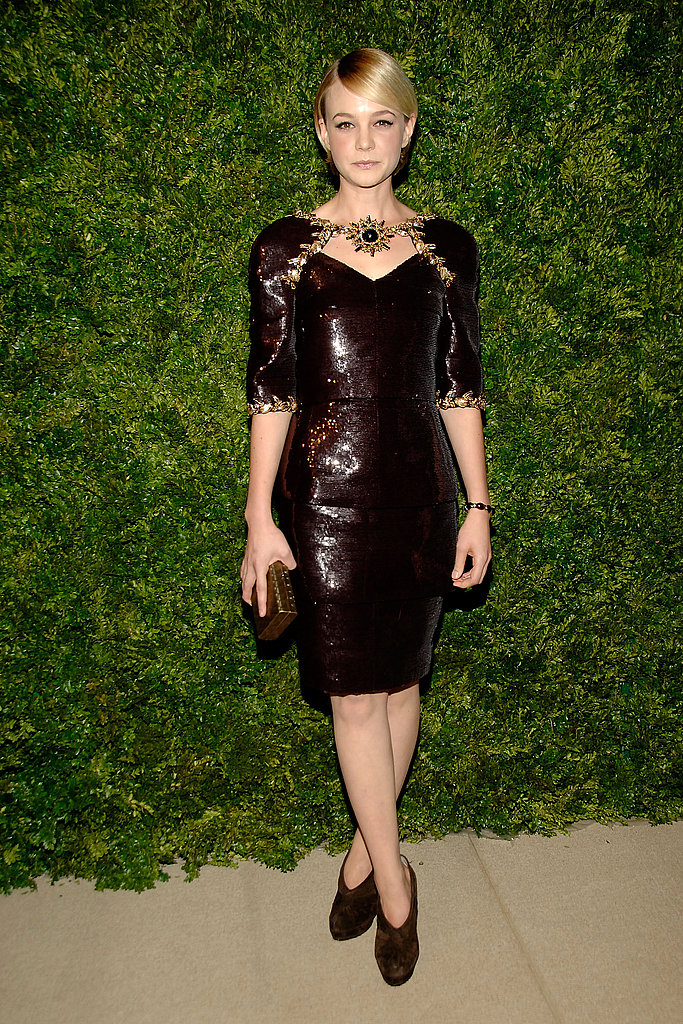 Carey Mulligan shimmered in a sparkly burgundy sheath.