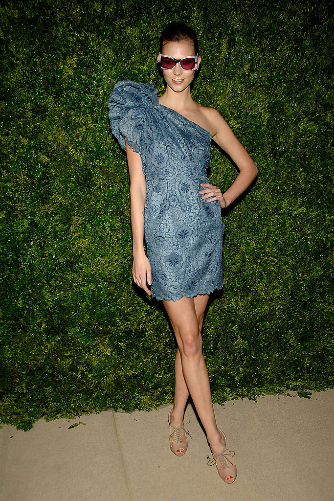 Karlie Kloss chose a one-shoulder confection from Stella McCartney Resort 2011 — and sunglasses at night.