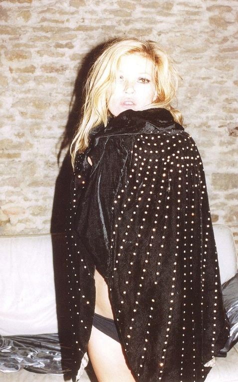 Wearing a '20s black rhinestone cape and Topshop panties.