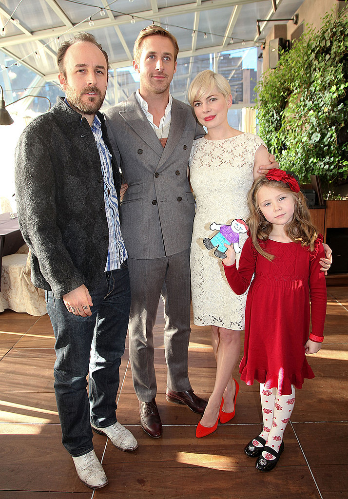 Michelle Williams made her ivory lace dress more modern via bright red pumps. Hot!