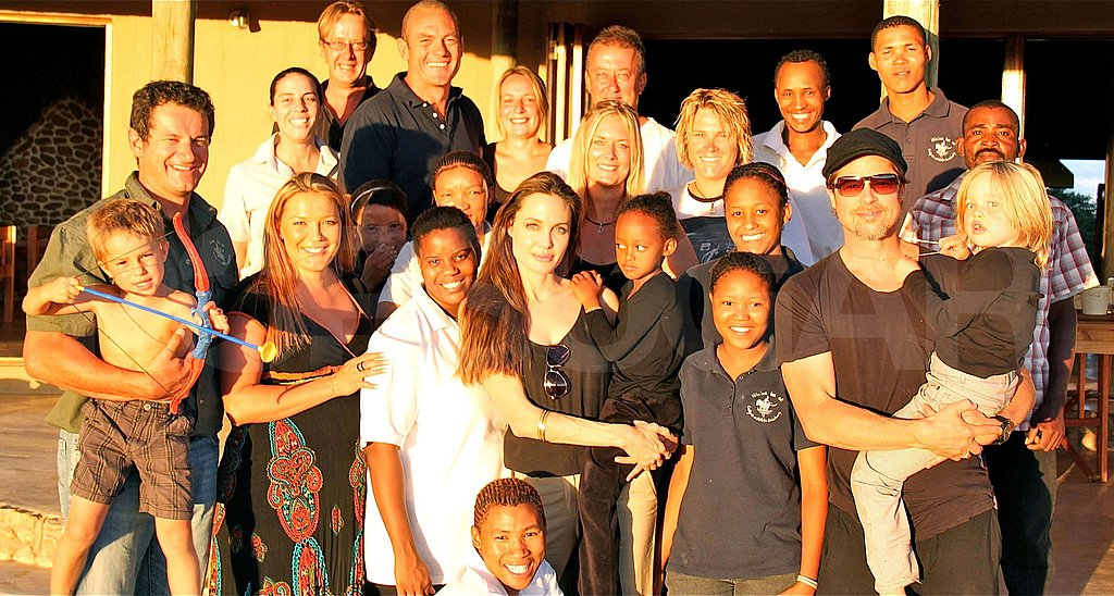 Angelina Jolie, Brad Pitt, Shiloh, and Zahara Pose With Their Christmas Hosts in Namibia!