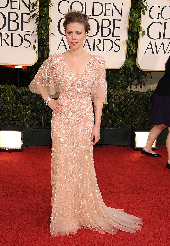 Scarlett Johansson worked the carpet in a nude, beaded Elie Saab gown.