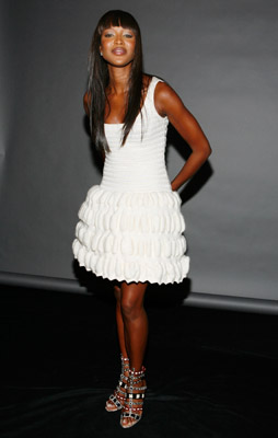 Naomi, who caused a buzz when she wore Alaia to her courtroom appearance at the Hague, wears all-white Alaia during a lighter moment.