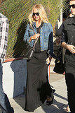 Rachel Zoe styles up her baby bump in a casual maxi and a denim jacket — maternity style done right.