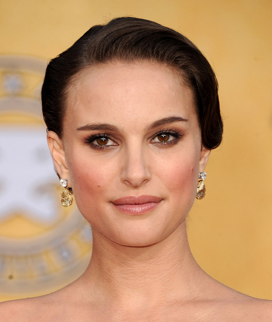 Natalie Portman's delicate diamond and gold earrings framed her face without stealing the spotlight.