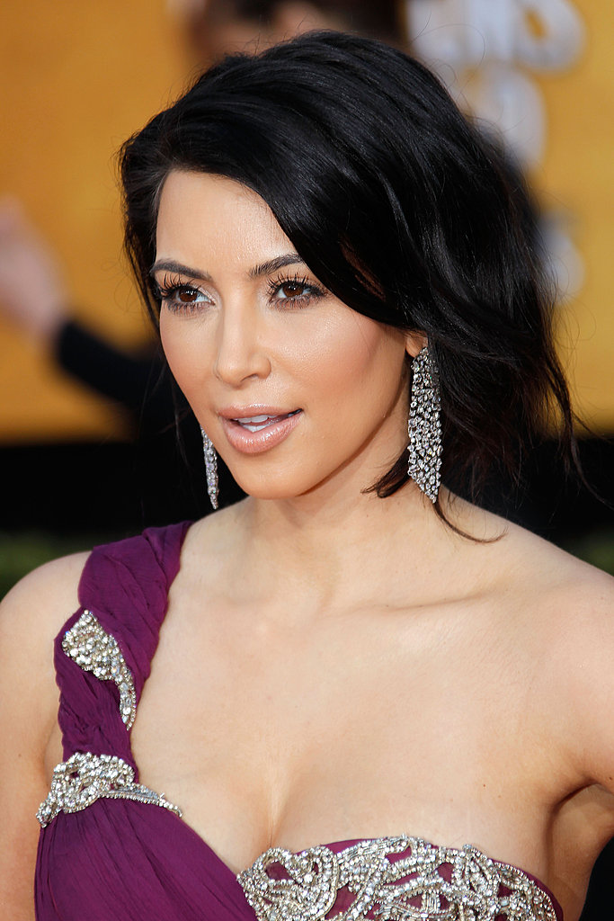 Kim Kardashian had plenty of shine on her dress, but she brought even more glitz via her chunky diamond earrings.