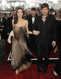 Angelina in an ombre strapless and Brad at her side in 2007.