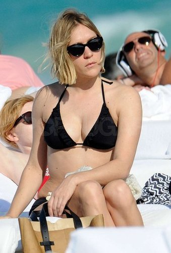Pictures of Chloë Sevigny Sunbathing in a Black Bikini in South Beach