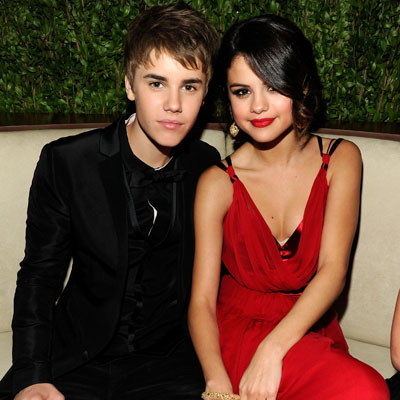 Photos of Justin Bieber and Selena Gomez Cuddling and Holding Hands at Vanity Fair 2011 Oscar Party