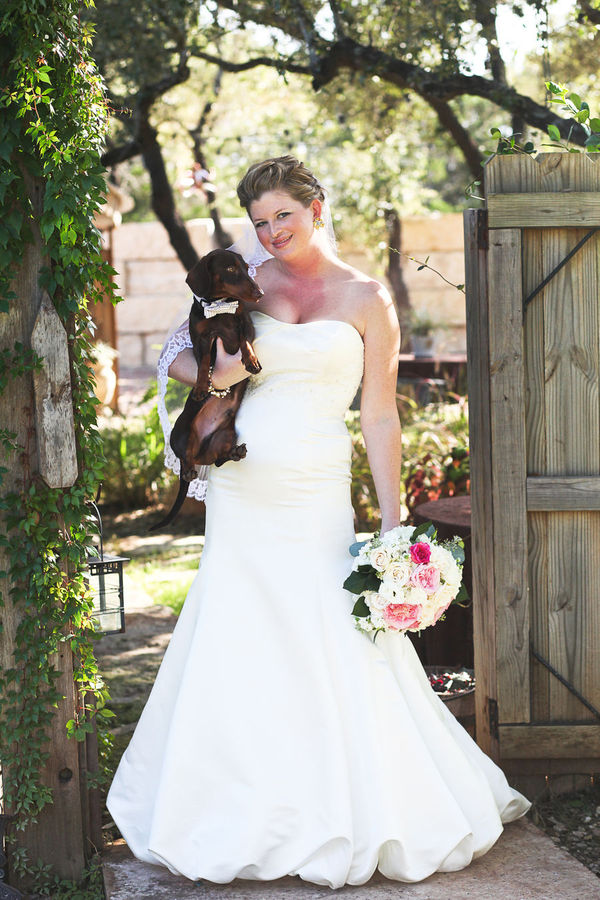 "When the officiant named this couple ""man and wife,"" their sweet little dog (and ring bearer) started barking!  Photo by Brittney Melton Photography"