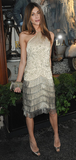 Showing off a vintage-glam moment in a shimmery beaded and fringed halter dress for a Ralph Lauren party last April.