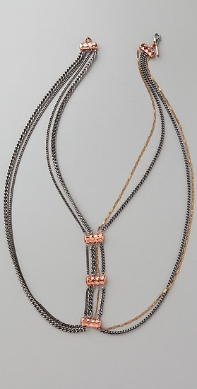 Throw this on with a blazer and a tank, and you need little else.  Vanessa Mooney the Alexandria Drape Necklace ($165)