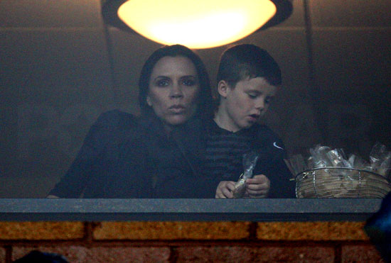 Victoria Beckham Brings Her Boys to Cheer On David in the Rain