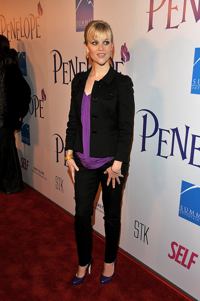 Reese Witherspoon in Black Suit and Purple Blouse
