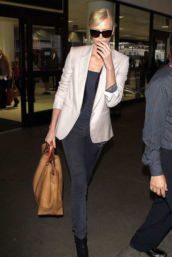 We love this polished-cool look from Charlize Theron — the color palette, the bag, the shoes, everything.