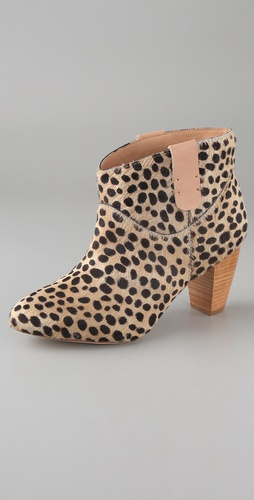 The leopard spots add a standout touch, and the low heels mean they won't leave your dogs barking post-partying.  Rebecca Minkoff Doll Pull Tab Booties ($375)
