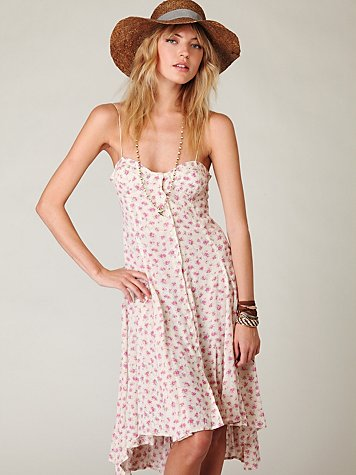 We love the soft floral print and asymmetrical hemline. Free People New Romantics First Bloom Maxi Dress ($148)
