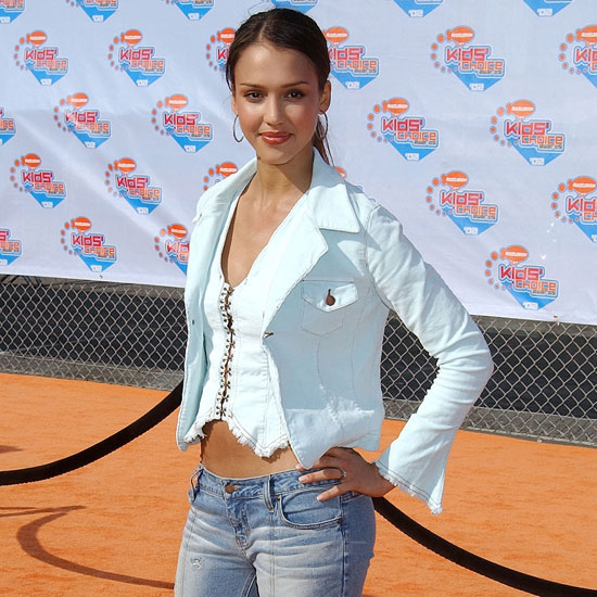 Jessica Alba had her abs on display on the orange carpet.