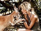 Anja Rubik gets cuddly with a kangaroo.