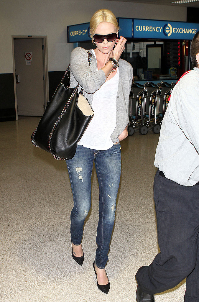 Charlize Theron sported an enviable travel ensemble — both polished and laid-back cool.