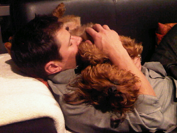 The cute animal exception applies again. Vanessa Minnillo catches Nick asleep with the puppy dogs.