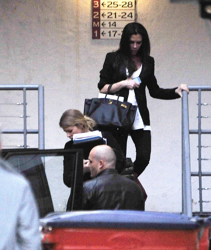 Victoria Beckham Covers Her Bump During a Long Work Day in London