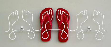 Why should coats and hats have all the fun? Hang your flip-flops on the wall too with this pairs-of-feet Shoe Rack ($62).