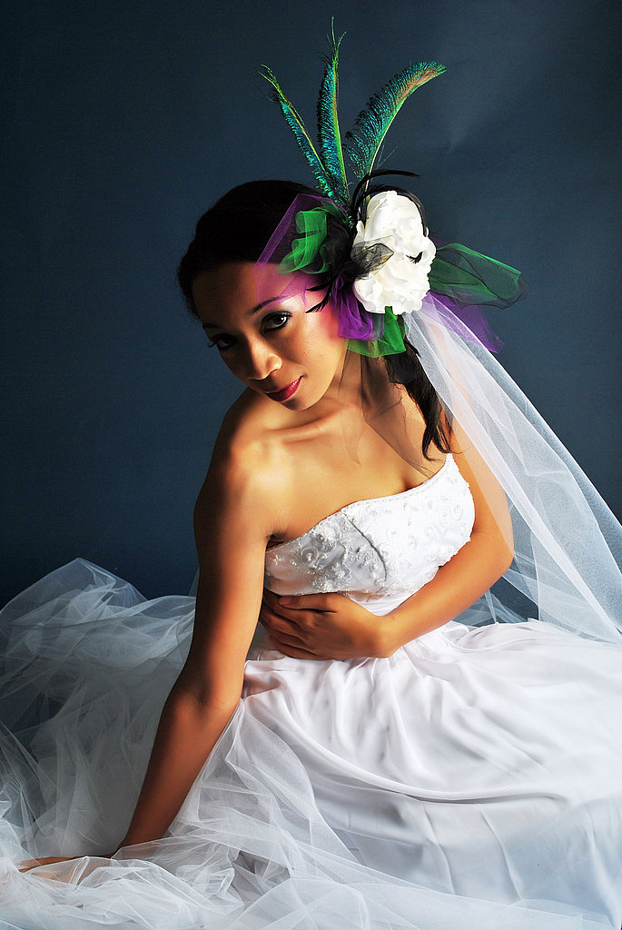 A bright purple and green fascinator adds dramatic elegance.  Source: Flickr user cherie6c