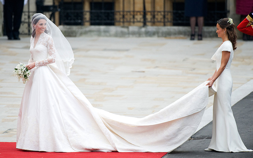"Kate stepped out of her car revealing her gorgeous Alexander McQueen wedding dress while Pippa helped with her train.  Pippa said to Kate, ""You look wonderful"" to which Kate replied, ""People have been working on it for days."" Pippa then said, ""You look amazing."""