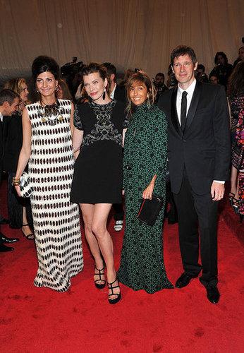 Giovanna Battaglia, Milla Jovovich, and Consuelo Castiglioni, all in Marni, and Paul Anderson
