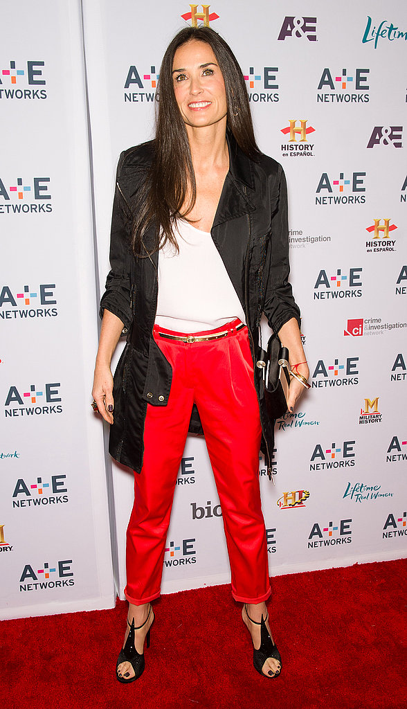 Demi Moore rocked red trousers for a look that's chic and easy.