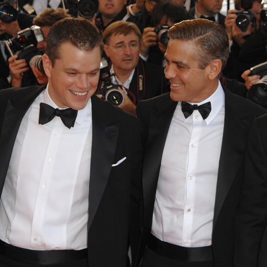 Matt Damon and George Clooney shared a laugh on the Ocean's 13 red carpet in 2007.