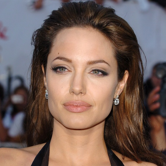 For the premiere of Mr. and Mrs. Smith, Angelina donned a sexy black leather dress, and amped up the look with a brushed-back hairdo and some serious cat-eye liner.