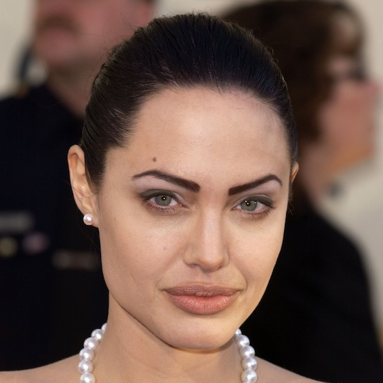 At the 2002 Golden Globes, Angelina tried light-colored lipstick yet again, but this time with a much-talked about bold eyebrow look.