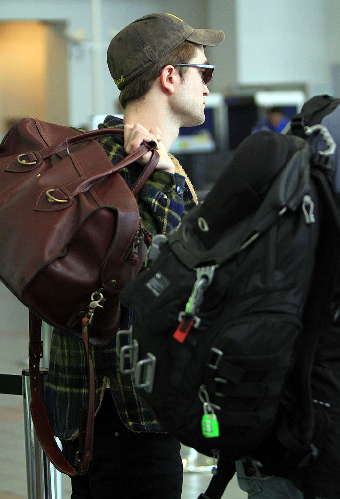 Robert Pattinson Makes His West Coast Arrival Prior to the MTV Movie Awards and a Breaking Dawn Reveal