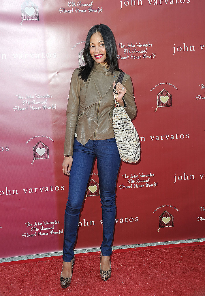 Zoe went jeans-and-heel casual for a daytime event in March 2011.