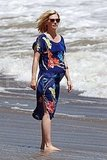 January Jones showing her baby bump on the beach.