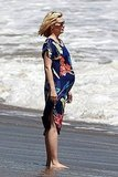 January Jones looks pregnant at the beach.