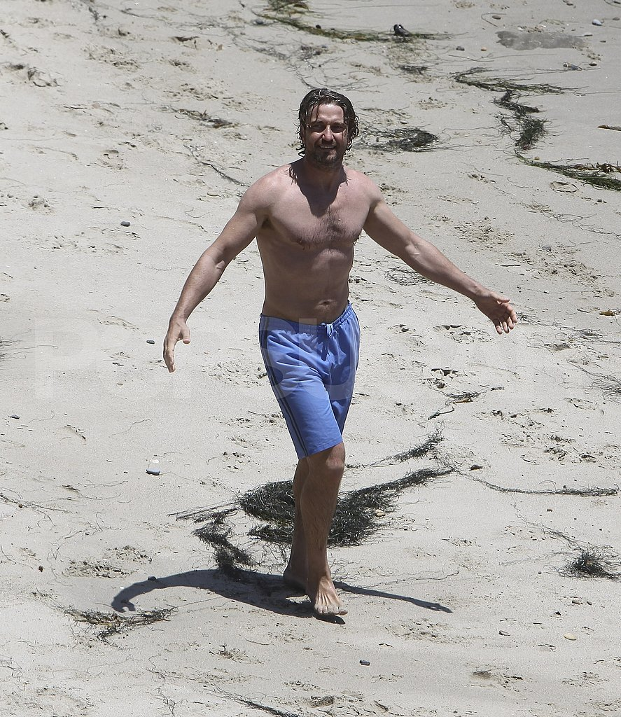 Gerard Butler shirtless at the beach.