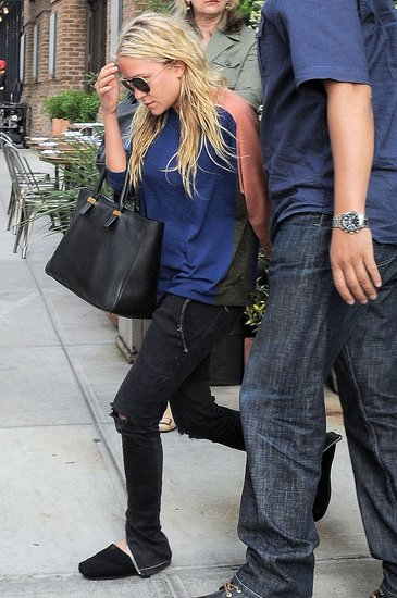 Mary-Kate Olsen left lunch with bodyguards.
