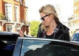 Kate Moss hopping into a car.
