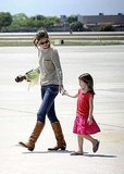 Katie Holmes and Suri Cruise boarded a plane in Miami.