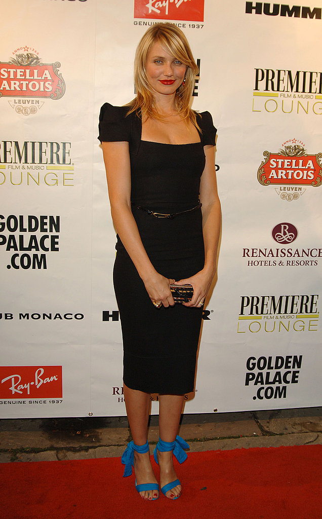 A sophisticates sheath with a flirtatious finish — check out those lace-up heels — at the Toronto Film Fest in '05.