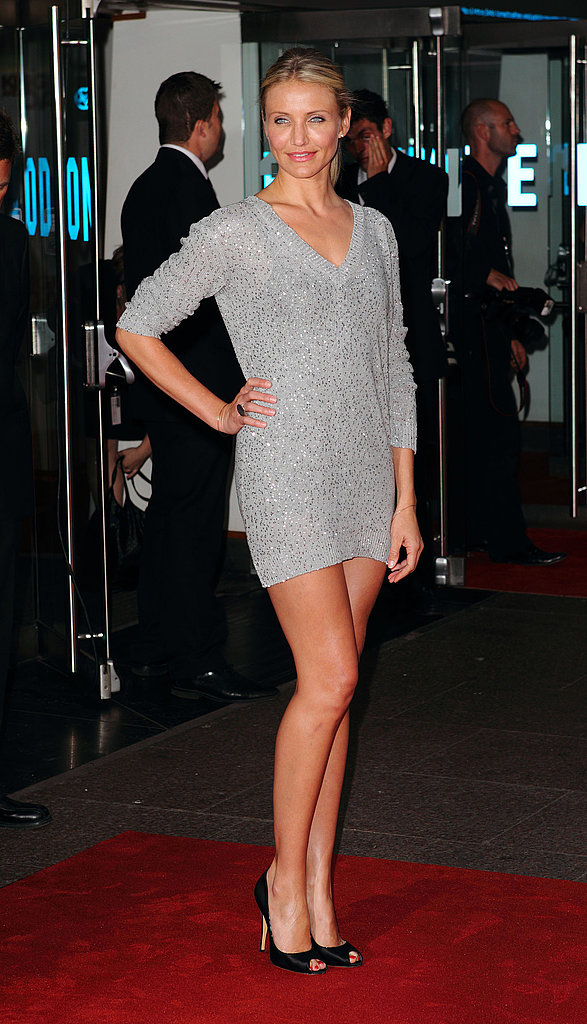 Adding some sex appeal to a knit sweater dress with black peep-toes for the Knight and Day premiere in 2010.