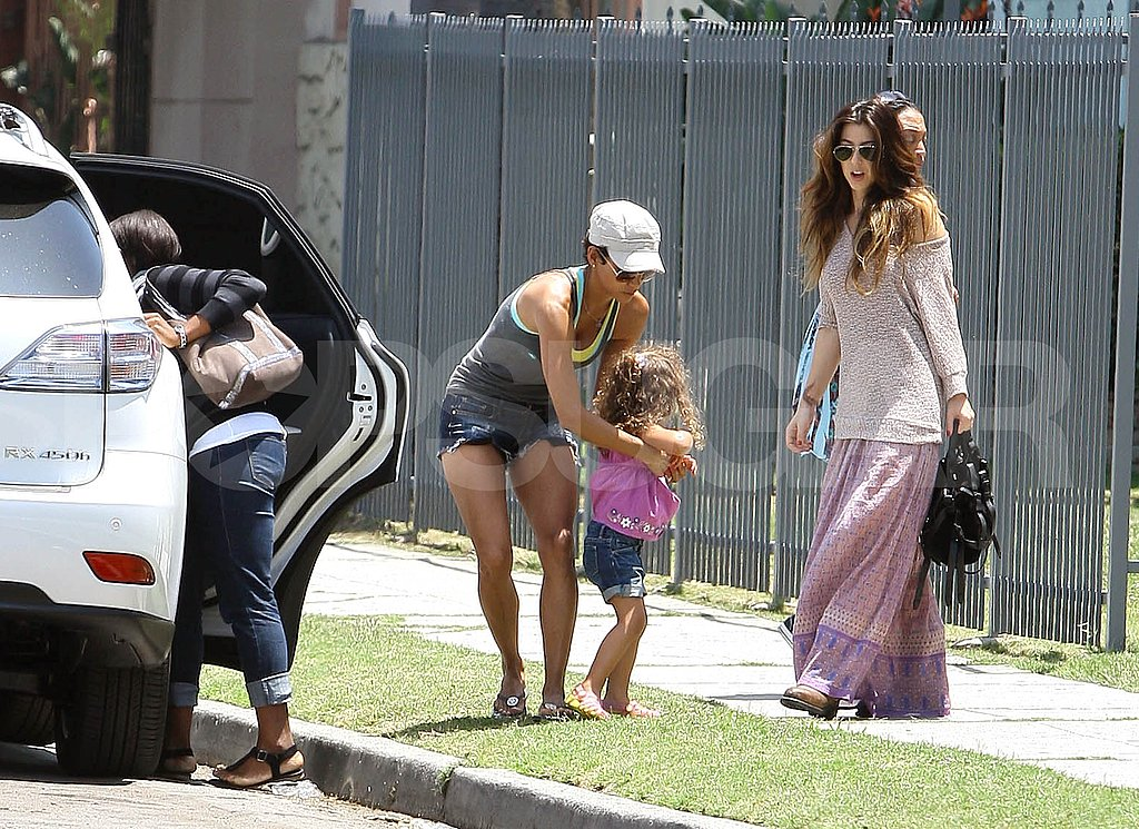 Halle Berry carrying daughter Nahla Aubry.