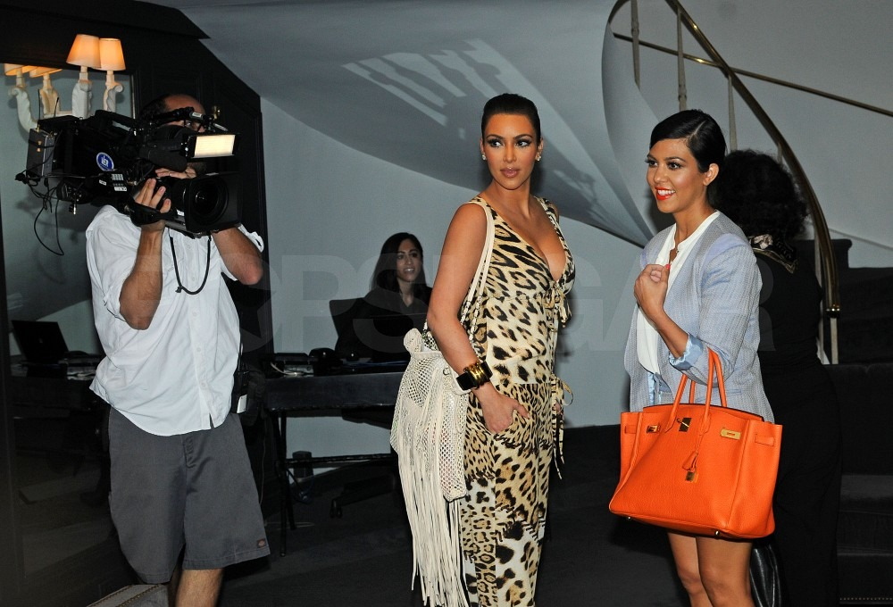 Kim wore Chanel and Kourtney Kardashian carried Hermes.