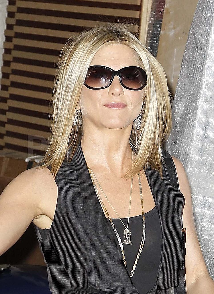 Jennifer Aniston wore her blond hair down.